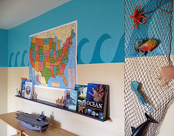 I build that shelf to hold all of his ocean books. The map is for marking all the Aquariums we visit in the United States.