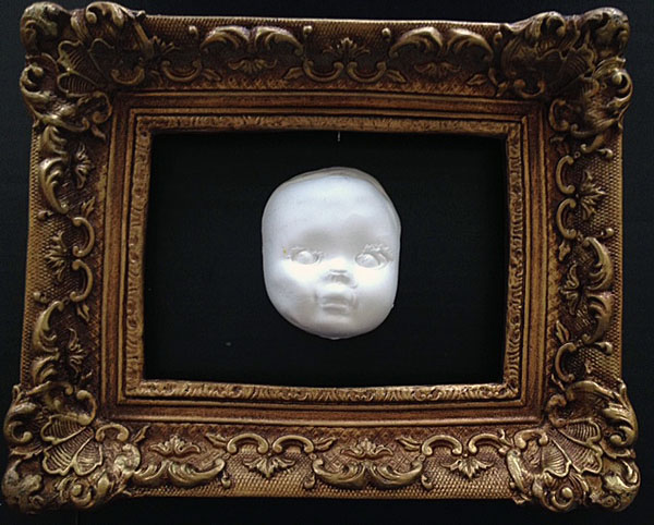 Doll face mold in frame